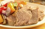 Boiled beef with baked vegetables