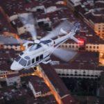 Firenze, elicottero A139 della Polizia di Stato in volo con 8° Reparto Volo di Firenze al crepuscolo sopra la città 2016-02-18 © Massimo Sestini Foto Massimo Sestini