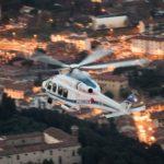 Firenze, elicottero della Polizia di Stato in volo con 8° Reparto Volo di Firenze al crepuscolo sopra la città 2016 02 18 © Massimo Sestini